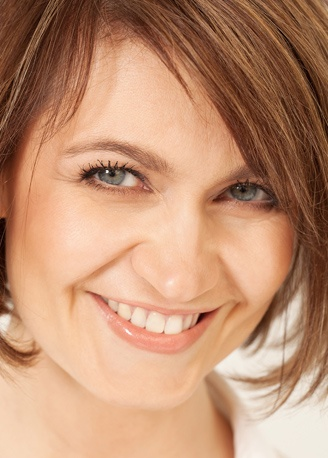 women has professional teeth whitening service in order to make her white smile